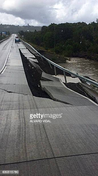 View of a bridge damaged by a 77magnitude earthquake in Castro on Chiloe Island off the Pacific coast of southern Chile on December 25 2016 A strong...