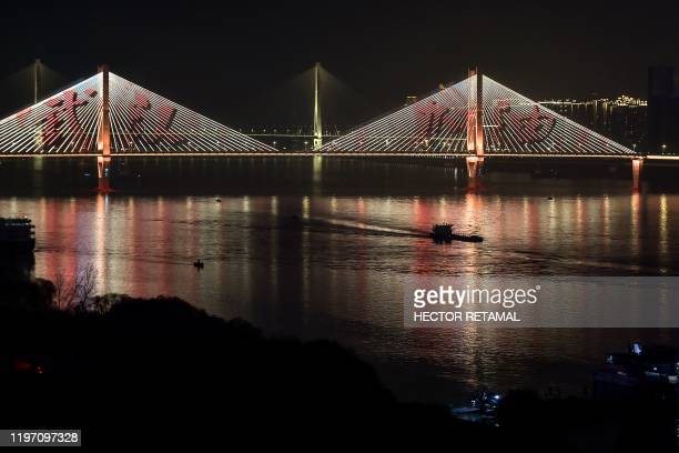 A view of a bridge with a message in Chinese that reads Go Wuhan is pictured in Wuhan in China's central Hubei province on January 27 amid a deadly...