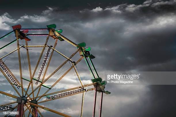 View of a brightly lit Ferris wheel against a dark autumn sky, taken on October 13, 2012.