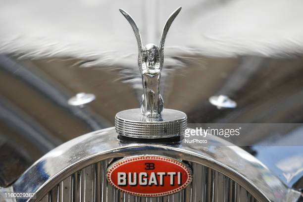 View of a Bugatti logo and hood ornament on a vintage Bugatti parked in Bayeux center. On Wednesday, July 31 in Caen, Calvados, Normandy, France.