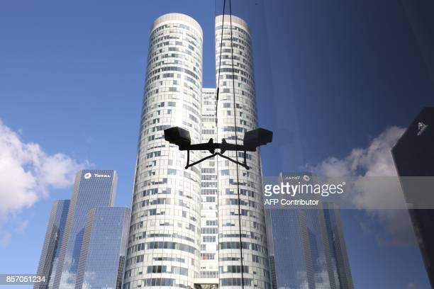A view of a building in the La Defense business district in Courbevoie on October 3 2017 / AFP PHOTO / LUDOVIC MARIN
