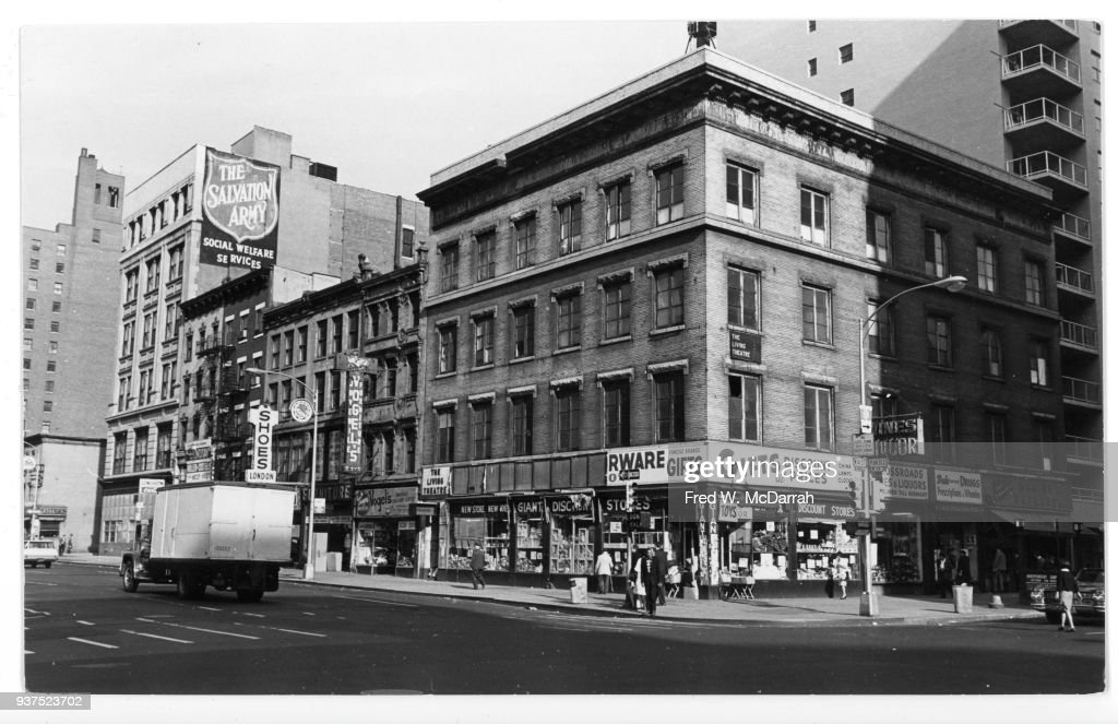 View of a building on the northeast corner West 14th Street and 6th Avenue, New York, New York, October 20, 1965. Among other businesses, the building was home to the Living Theatre (see signage on the ground floor to left, and on the third floor to right) and Merce Cunningham's dance studio (on the top floor).