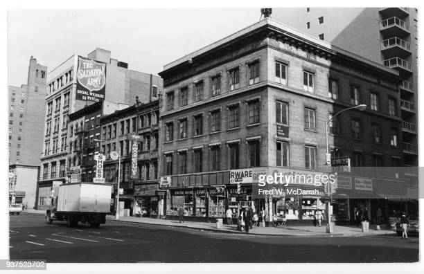 View of a building on the northeast corner West 14th Street and 6th Avenue New York New York October 20 1965 Among other businesses the building was...
