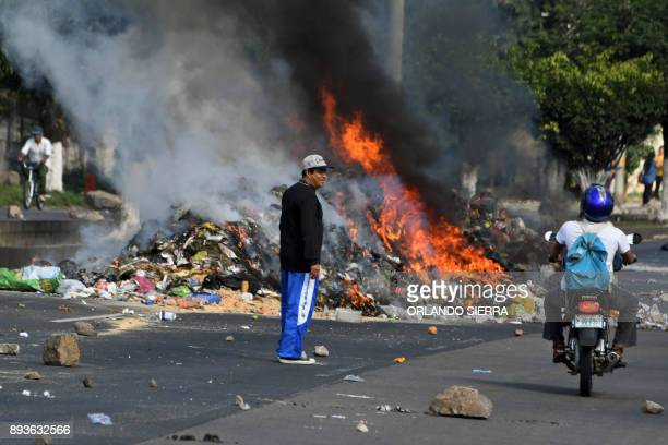 View of a burning barricade made out of garbage and set up across 'Fuerzas Armadas' boulevard by supporters of presidential candidate for the...