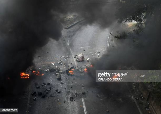 View of a burning barricade set up by supporters of presidential candidate for the Opposition Alliance against Dictatorship party Salvador Nasralla...