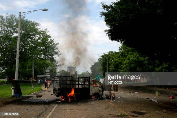 View of a burnt truck during protests in Masaya some 40km southeast of Managua on May 15 2018 Nicaragua's powerful Roman Catholic bishops announced...