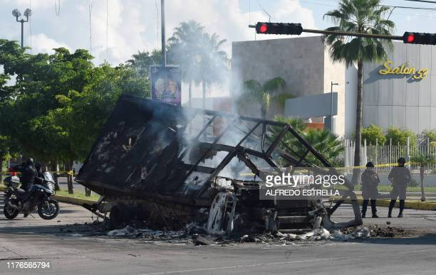 View of a burnt vehicle after heavily armed gunmen waged an allout battle against Mexican security forces in Culiacan Sinaloa state Mexico on October...