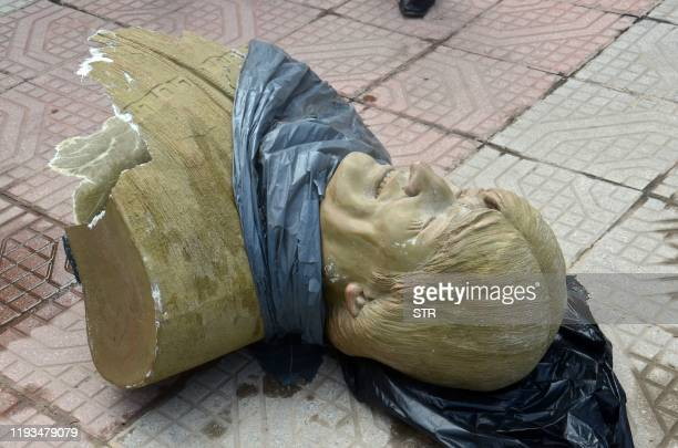 View of a bust of Bolivian ex-President Evo Morales after it was knocked down by employees of the Bolivian Ministry of Sports outside a sports center...