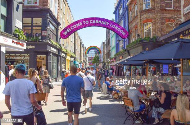 View of a busy Carnaby Street in Central London as the heatwave continues in England.