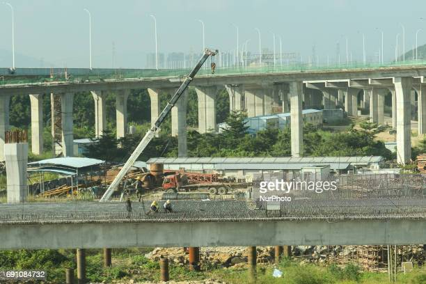 A view of a busy construction site along the road from Liling to Qingyuan On Friday September 23 2016 in Qingyuan China