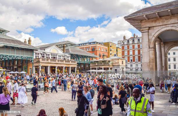 View of a busy Covent Garden Market, as tourists return to the capital following the relaxation of coronavirus restrictions and quarantine rules in...