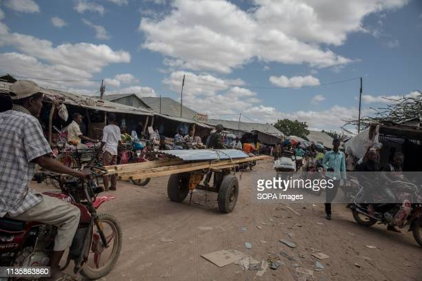 View of a busy market area in the refugee camp. Dadaab is one of the largest refugee camps in the world. More than 200,000 refugees live there -...