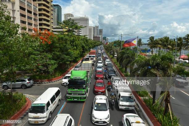 A view of a busy Roxas Boulvard in Manila center On Sunday June 30 in Manila Philippines