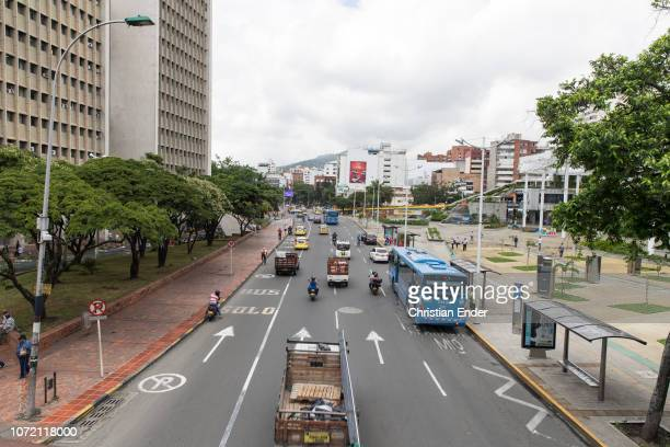 A view of a busy street shot from a pedestrian's bridge showing an urban landscape in Cali Colombia