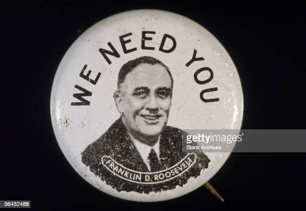 View of a campaign button promoting the presidential bid of Franklin Delano Roosevelt which features FDR's face under the text 'We Need You' early...