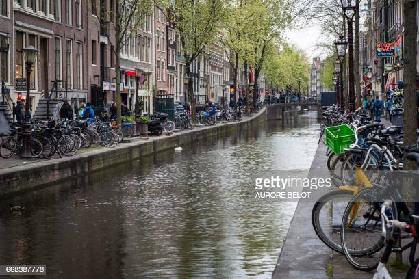 View of a canal in the red district in Amsterdam on April 12 2017 / AFP PHOTO / Aurore Belot