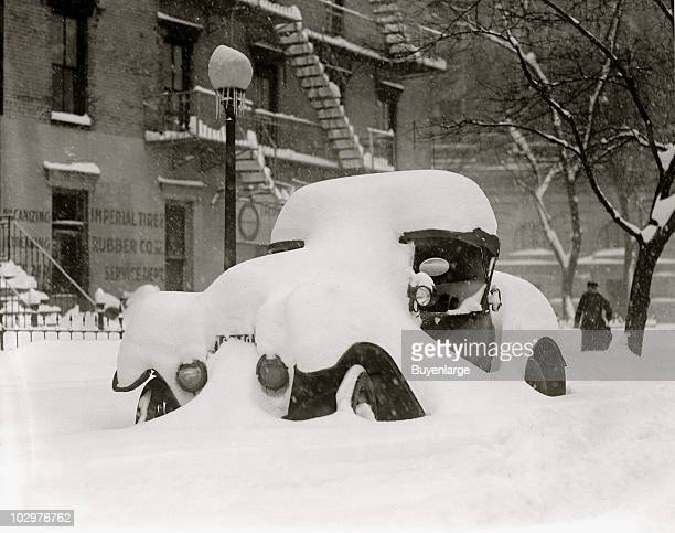 View of a car buried in snow during the socalled Knickerbocker Storm a blizzard that dropped 28 inches of snow on Washington DC January 28 1922 The...