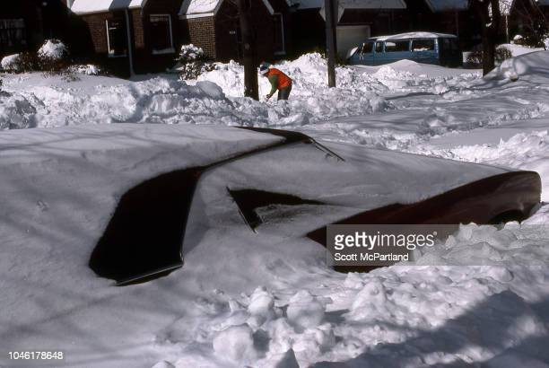 View of a car buried under snow in the aftermath of a blizzard Queens New York New York February 13 1983