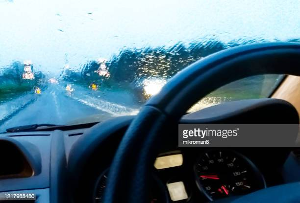 view of a car dashboard and a window during rain - storm cloud stock pictures, royalty-free photos & images