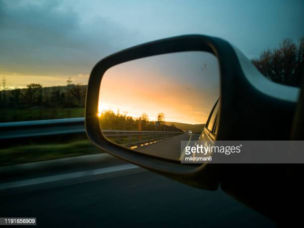 view of a car wing mirror. sunset time - side view stock pictures, royalty-free photos & images