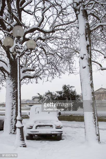 A view of a car with snow drawings as snow falls on February 7 2018 in Paris France According to the weather forecast it will snow heavily during the...