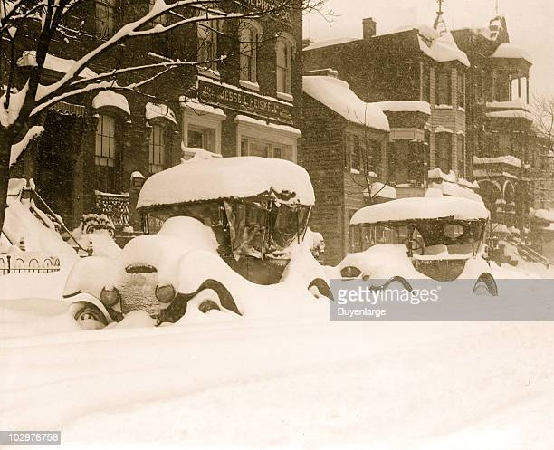 View of a cars buried in snow during the socalled Knickerbocker Storm a blizzard that dropped 28 inches of snow on Washington DC January 28 1922 The...