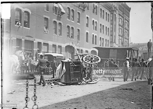 View of a cart overturned during a teamsters strike June 4 1902 The cart is lying on its side at Van Buren Street and 5th Avenue in Chicago Illinois...
