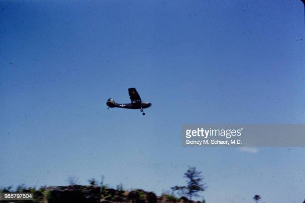 View of a Cessna L19 Bird Dog observation plane as it flies overhead South Korea May 1952