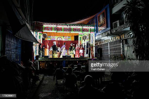 A view of a Chinese Opera stage set up in a small side street in Bangkok's Chinatown district Chinese opera is performed in Thailand by itinerant...