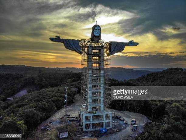 View of a Christ statue being built in Encantado, Rio Grande do Sul state, Brazil, on April 09, 2021. - The Christ the Protector statue under...