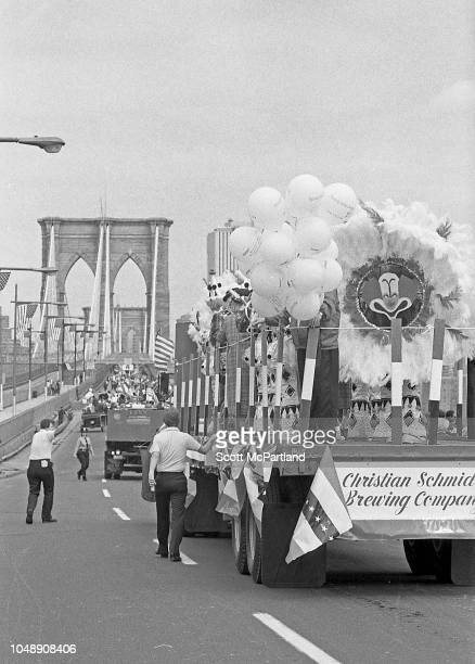 View of a Christian Schmidt Brewing Company truck as it makes its way across the Brooklyn Bridge during a parade in honor of the bridge's 100th...