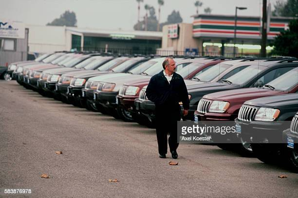 View of a Chrysler dealership overstocked with vehicles as the end of 2000 approaches