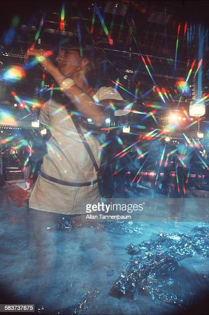 View of a clubgoer amid the light towers on the dance floor at Studio 54 New York New York mid to late twentieth century