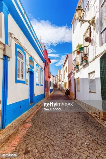 View of a cobblestone street, town of Burgau, Algarve region, Portugal