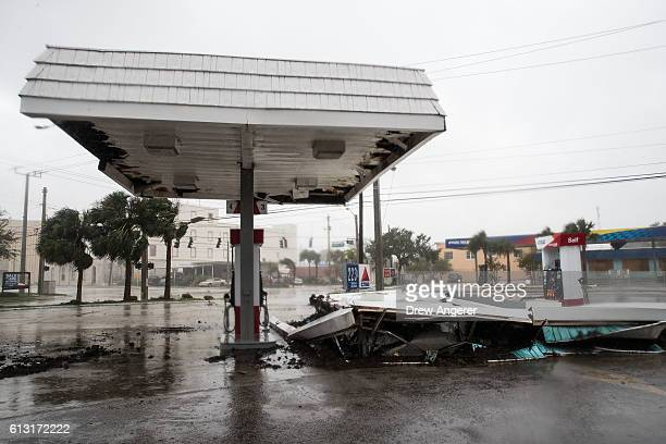 A view of a collapsed roof at a gas station after Hurricane Matthew passes through on October 7 2016 in Daytona Beach Florida Florida Georgia South...