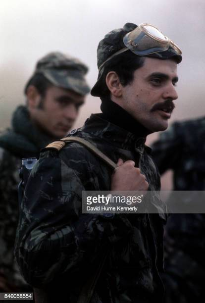 View of a Colonial Portuguese solder his rifle over his shoulder as he stands with fellow troops Ancuabe Cabo Delgado Province Mozambique July 27...