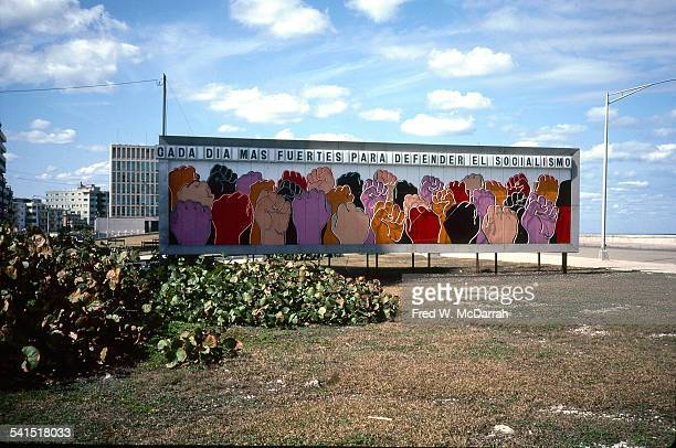 View of a colorful billboard on the exit road to Jose Marti International Airport Havana Cuba January 27 1983 The text reads 'Cada dia mas fuertes...