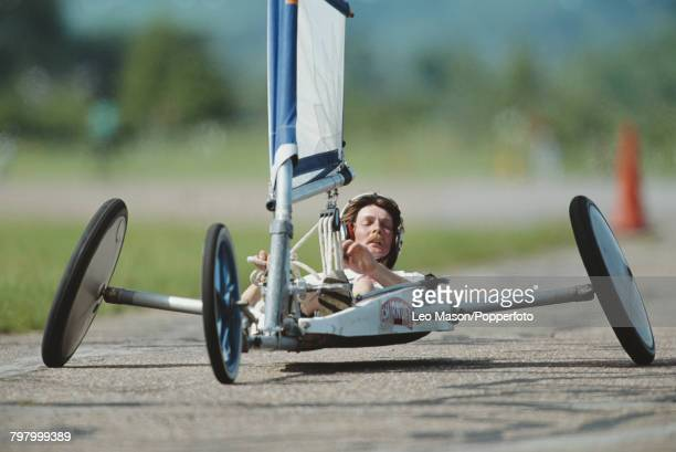 View of a competitor steering a sand yacht in a land sailing event at RAF Bassingbourn airfield in Cambridgeshire England in 1992