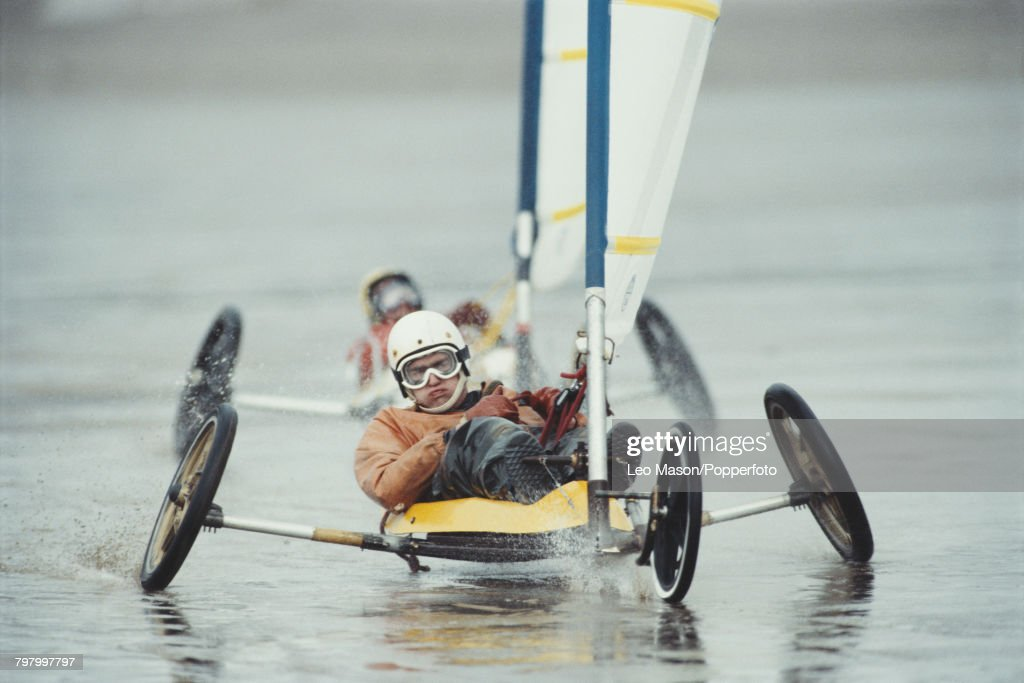 View of a competitor steering a sand yacht in a land sailing (land yachting) event on Brean beach in Somerset, England in 1990.