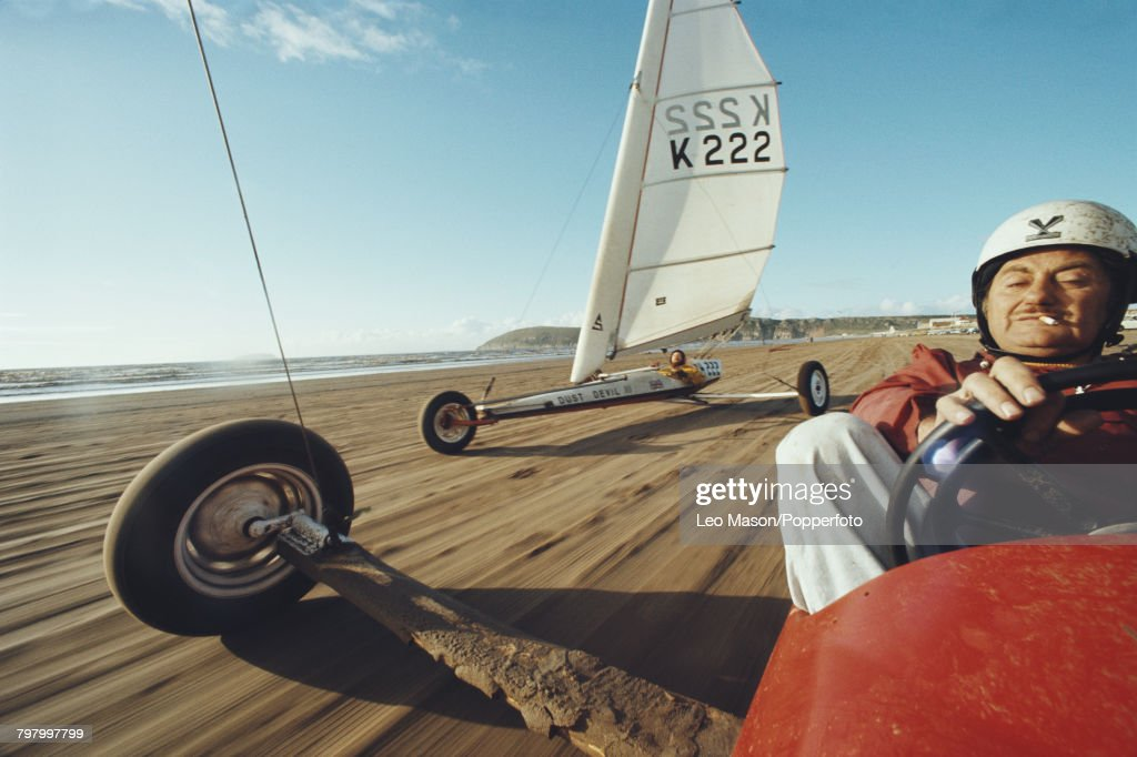 View of a competitor steering a sand yacht in a land sailing event on Brean beach in Somerset, England in September 1977.