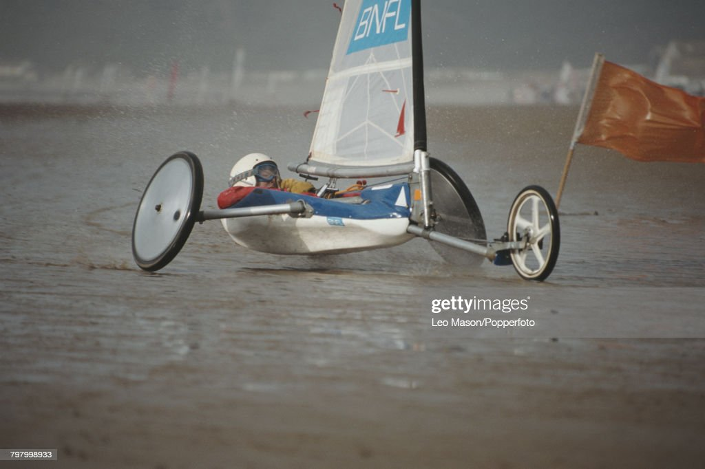 View of a competitor steering a sand yacht in a land sailing (land yachting) event on Brean Beach in Somerset, England in 1995.