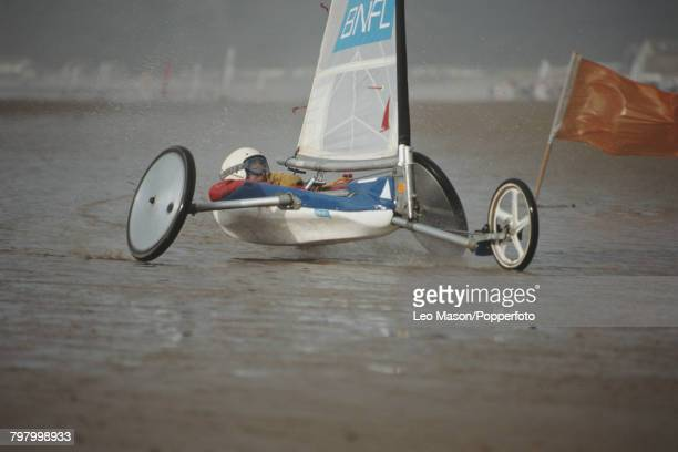 View of a competitor steering a sand yacht in a land sailing event on Brean Beach in Somerset England in 1995