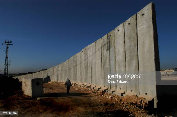 View of a concrete security wall in Kalandia separating the West Bank city near Ramalla from East Jerusalem November 10 2004 The huge concrete...