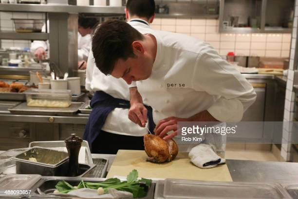 A view of a cook preparing a dish at Starwood Preferred Guest's Gourmet Experience of a Lifetime with Chef Thomas Keller at Per Se for Luck SPG...