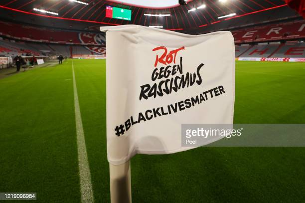 A view of a corner flag referring to the Black Lives Matter movement during the DFB Cup semifinal match between FC Bayern Muenchen and Eintracht...