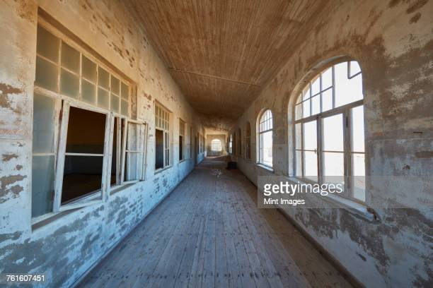 A view of a corridor in a derelict building.