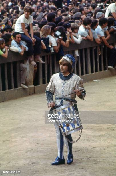 View of a costumed drummer as he performs for the crowd during the opening ceremony of the Palio Di Siena horse race in Siena Italy August 16 1968...