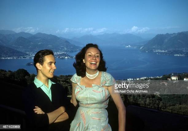 A view of a couple with Lake Maggiore in the background in Stresa Italy
