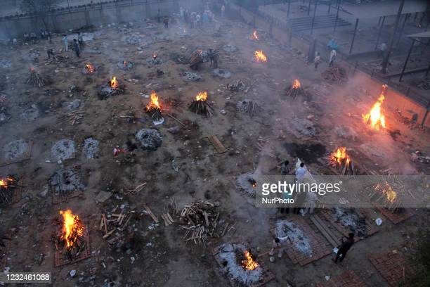 View of a crematorium ground where mass cremation of victims who died due to the coronavirus disease , is seen at a crematorium in New Delhi on April...