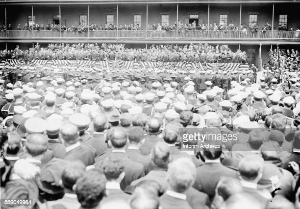 View of a crowd at Brooklyn's Navy Yard as they listen to US President Woodrow Wilson during a National Memorial Service to honor fallen servicemen...